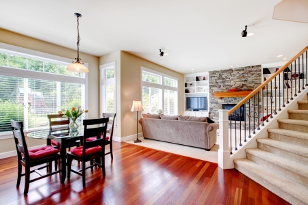 Large living and dining room with staircase, cherry hardwood Stock Photo - 15960586