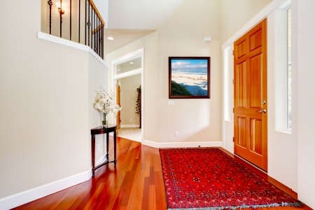 Large home luxury entrance with red rug and wood door  Stock Photo - 15959934
