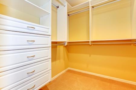 walk in closet: White shelves in lareg walk in closet