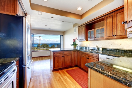 Beautiful Apartment kitchen with water view and granite Stock Photo - 16306556
