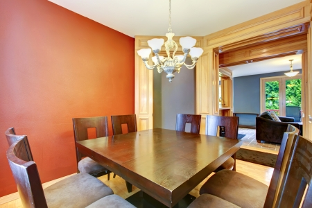 Dining room in red and blue and large wood table