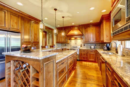 on kitchen: Mountain luxury home with wood kitchen and granite countertop.