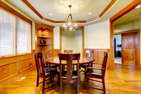 wood molding: Dining luxury  room with wood molding and floor.