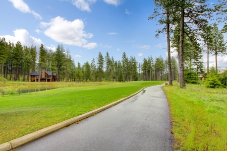 Gold course trail with pine trees and homes after the rain. Stock Photo - 16662835