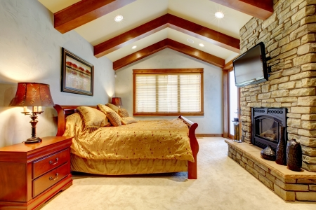 Mountain home luxury bedroom with blue walls and fireplace. Stock Photo - 16662826