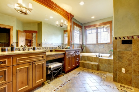 double sink: Luxury large master bathroom in mountain home with double sink and green walls. Stock Photo