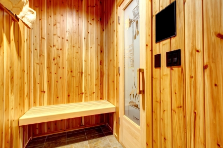luxuries: Home small sauna spa with cedar wood walls and bench.