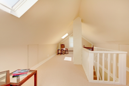 attic: Bright clean attic in the small home with beige carpet.