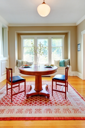 Beautiful decor of dining room with beige, blue and red. photo