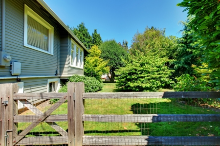 House and shed in the back yard with old wooden fence. Stock Photo - 16727889