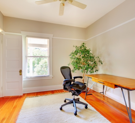 designer chair: Home office room interior with desk and beige walls.