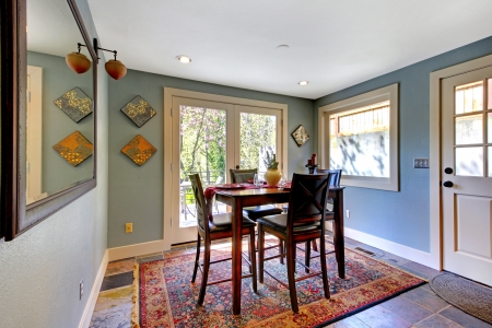 decoration: Blue bright dining room with red rug and high table.