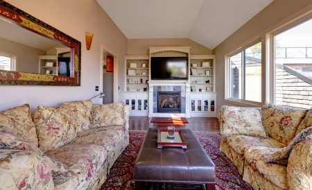 Large living room with sofa, TV and brown walls with beige carpet. photo