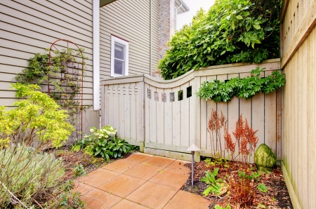 Gates and fence to the backyard with side of the hosue  Stock Photo - 16752258
