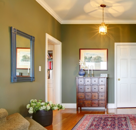 Classic Hallway with green walls, flowers and rug  photo