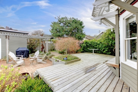 House large deck and backyard during early spring Stock Photo - 16752254