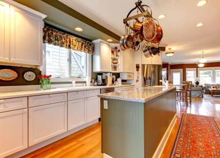 Large white and green kitchen with hardwood floor  photo