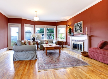 Large nice living room with red walls and fireplace  Stock Photo - 16752299