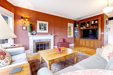 Large nice living room with red walls and fireplace