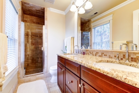 Large bathroom interior  with cherry cabinets and granite countertop. Stock Photo - 17056391