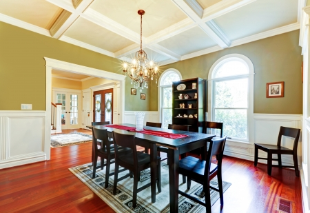 mold: Luxury elegant green dining room with cherry floor.
