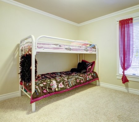 Kids simple bedroom with double bunk metal bed. photo