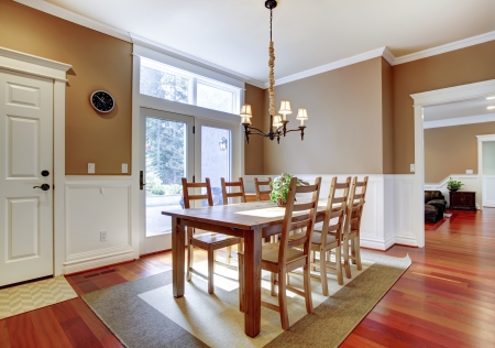 Large bright beige dining room with cherry hardwood. photo