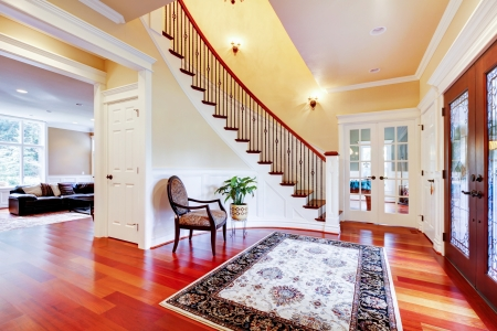 Luxury home entrance with cherry hardwood floor and staircase. Stock Photo - 17056355