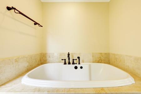 Nice new empty bathroom with large white tub Stock Photo - 17056382