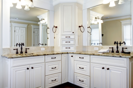 bathroom interior: Luxury large white master bathroom cabinets with double sinks. Stock Photo