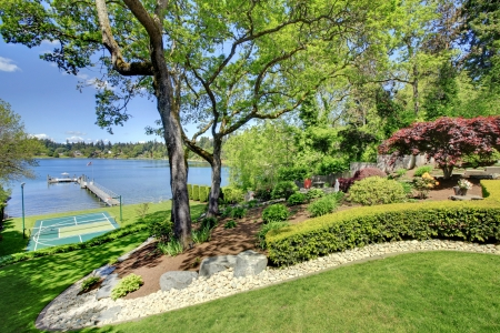 Luxury real estate lake view from home balcony with beautiful yard landscape. Stock Photo - 17056326