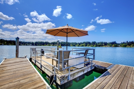 private party: Lake with wood pier and private party raft.
