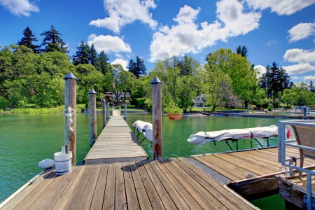 private party: Lake with long wood pier and private party raft. Stock Photo