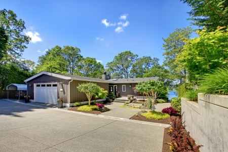 Beautiful home with garage, lake view and large front yard. Stock Photo - 17056336