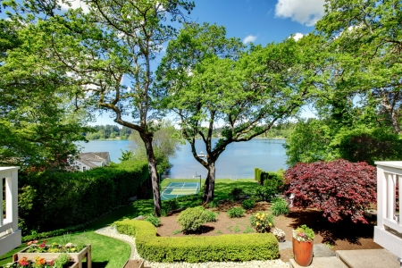 luxuries: Luxury real estate lake view from home balcony with beautiful yard landscape. Stock Photo