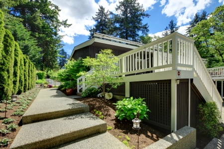 Large house back yard with large deck and walkway. Stock Photo - 17056346