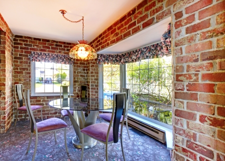 Breakfast table with brick walls and old carpet. Stock Photo - 17100618