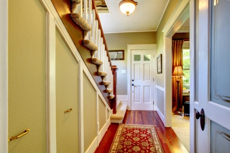 furnished apartments: Home classsic decor hallway with entrance front door. Stock Photo