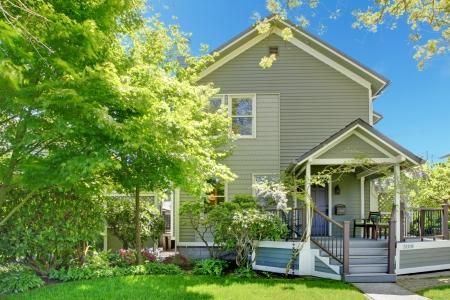american house: House spring grey exterior with entrance porch.