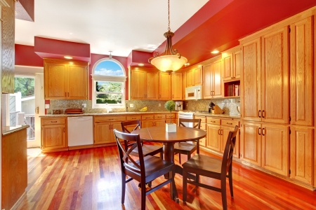 wood ceiling: Red beautiful large kitchen with cherry hardwood.