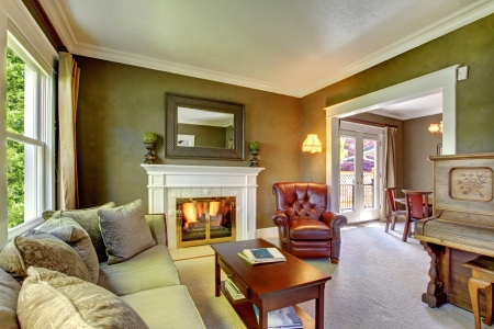 room: Elegant classic green living room with fireplace and piano.