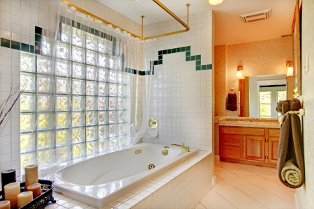 Bathroom with glass wall and tub. Stock Photo - 17100540