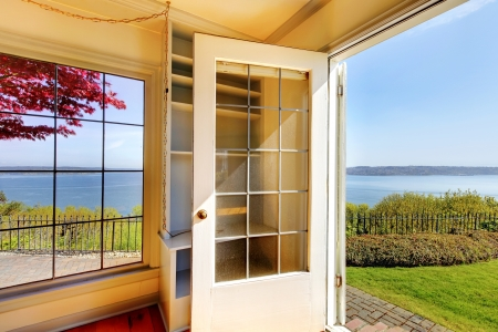Open door from the living room to the back yard with water view. Stock Photo - 17100614