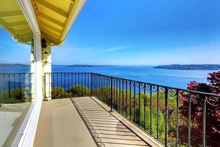 balcony window: House balcony with water amazing view and metal railings.