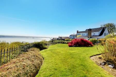 Houses with water view and spring landscape. Stock Photo - 17124881
