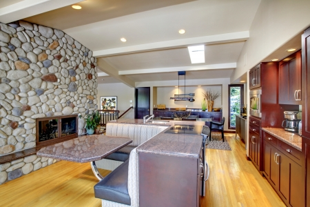 Luxury mohogany Kitchen with modern furniture and stone fireplace. Stock Photo - 17124834