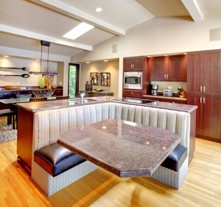 Luxury mahogany Kitchen with modern custom furniture design. photo