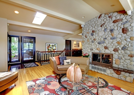 living room interior: Open modern luxury home interior living room and stone fireplace. Stock Photo