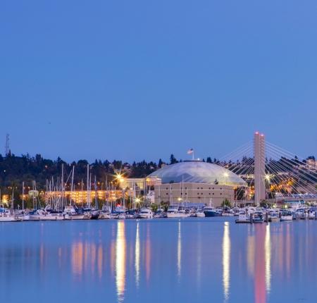 tacoma: Tacoma dome with boats and Marina. City downtown at night. Editorial