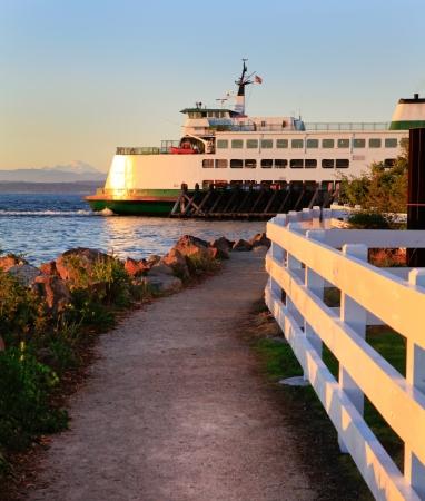 island: Mukilteo to Bainbridge Washington State ferry during sunset.